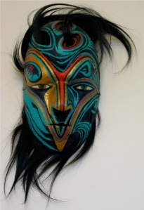 Otter-child mixed media mask by Kaleo Ching, poem by Elise Ching